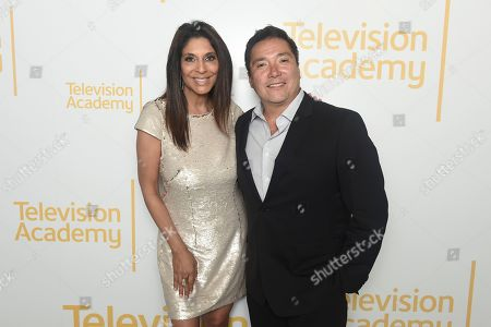Christine Devine, Denito Martinez. Christine Devine, left, and Denito Martinez pose for a portrait at the 71st Los Angeles Area Emmy Awards at the Saban Media Center at Television Academy's North Hollywood, Calif. headquarters on