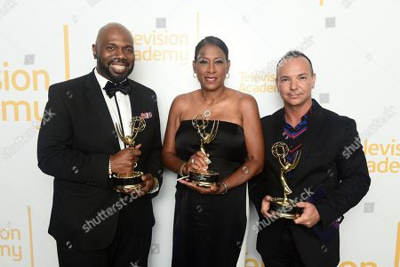"""Stock Image of Otis Easter, Pat Harvey, Michael Parrott. Otis Easter, from left, Pat Harvey, and Michael Parrott from CBS2, winners of the Emmy for live special news events for """"CBS2 News at 6: Fire Telethon"""", pose for a portrait at the 71st Los Angeles Area Emmy Awards at the Saban Media Center at Television Academy's North Hollywood, Calif. headquarters on"""