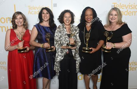 """Brenda Brkusic, Joe Fenstermaker, Karen Hunte, Ann Kaneko, Michelle Merker, Margo Newman,Laurie Parker, John Simmons, Pamela Tom. The team from PBS SoCal, winners of the Emmy for crime/social issues for """"Finding Home: A Foster Youth Story"""", pose for a portrait at the 71st Los Angeles Area Emmy Awards at the Saban Media Center at Television Academy's North Hollywood, Calif. headquarters on"""