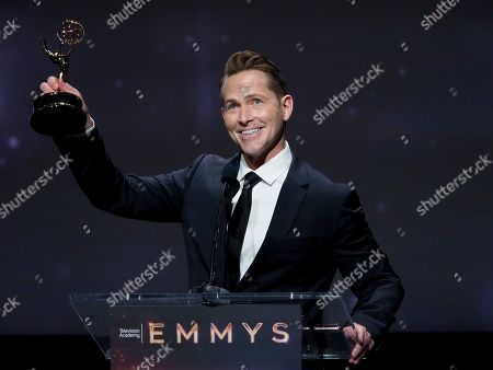 """Matt Johnson from KTTV-TV accepts the Emmy for crime/social issues news story for """"DNA Doe Project"""" at the 71st Los Angeles Area Emmy Awards at the Saban Media Center at Television Academy's North Hollywood, Calif. headquarters on"""