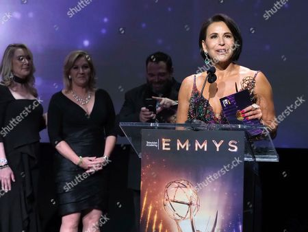 """EXCLUSIVE - Giselle Fernandez, right, and the team from The Spectrum News 1 Production Team accepts the Emmy for informational series (more than 50% remote) for """"LA Stories with Giselle Fernandez"""" at the 71st Los Angeles Area Emmy Awards at the Saban Media Center at Television Academy's North Hollywood, Calif. headquarters on"""