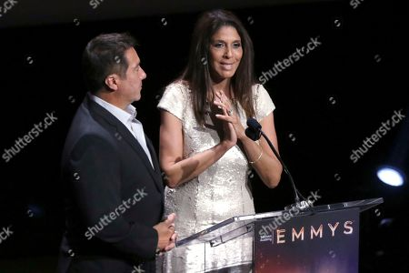 Christine Devine, Benito Martinez. Benito Martinez, left, and Christine Devine speak at the 71st Los Angeles Area Emmy Awards at the Saban Media Center at Television Academy's North Hollywood, Calif. headquarters on
