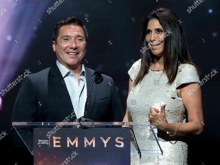 Benito Martinez, Christine Devine. Benito Martinez, left, and Christine Devine speak at the 71st Los Angeles Area Emmy Awards at the Saban Media Center at Television Academy's North Hollywood, Calif. headquarters on