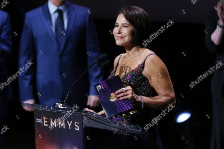 Stock Picture of Giselle Fernandez presents an award at the 71st Los Angeles Area Emmy Awards at the Saban Media Center at Television Academy's North Hollywood, Calif. headquarters on
