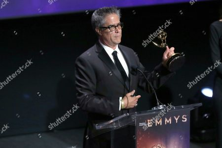 "Gregory Vincent Taylor of Spectrum SportsNet LA accepts the Emmy for sports feature for ""Kirk Gibson Ceremonial First Pitch"" at the 71st Los Angeles Area Emmy Awards at the Saban Media Center at Television Academy's North Hollywood, Calif. headquarters on"