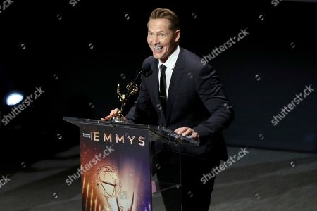 """Matt Johnson from KTTV-V accepts the Emmy for crime/social issues news story for """"DNA Doe Project"""" at the 71st Los Angeles Area Emmy Awards at the Saban Media Center at Television Academy's North Hollywood, Calif. headquarters on"""