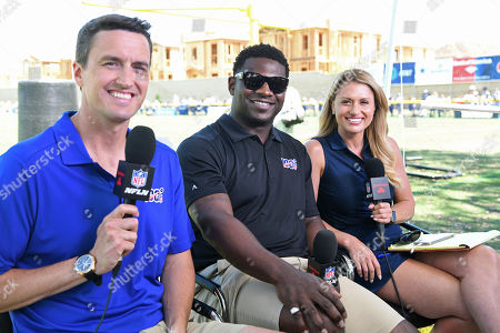 """Stock Photo of Rhett Lewis, LaDainian Tomlinson, Jane Slater. Rhett Lewis, left, LaDainian Tomlinson and Jane Slater broadcast for """"Inside Training Camp Live"""" on the NFL network from the Dallas Cowboys' training camp in Oxnard, Calif"""