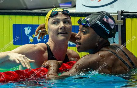 Third placed Cate Campbell of Australia (L) and winner Simone Manuel of the United States of America (USA) hug each other after competing in the womenÕs 50m Freestyle Final during the Swimming events at the Gwangju 2019 FINA World Championships, Gwangju, South Korea, 28 July 2019.