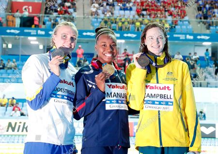 Silver medalist Sarah Sjoestroem of Sweden (L) Gold medalist Simone Manuel of  USA (C) and Bronze medalist Cate Campbell of Australia (R) pose for photographs during the award ceremony for the women's 50m Freestyle final at the FINA Swimming World Championships 2019 in Gwangju, South Korea, 28 July 2019.