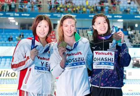 Silver medalist Ye Shiwen of China (L) Gold medalist Katinka Hosszu of Hungary (C) and Bronze medalist Yui Ohashi of Japan (R) pose for photographs during the award ceremony for the women's 400m Individual Medley final at the FINA Swimming World Championships 2019 in Gwangju, South Korea, 28 July 2019.