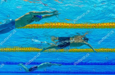 (From top) Third placed Vladimir Morozov of Russia, second placed Nathan Adrian of the United States of America (USA) and winner Duncan Scott of Great Britain at the beginning of the final leg in the men's 4x100m Medley Relay Final during the Swimming events at the Gwangju 2019 FINA World Championships, Gwangju, South Korea, 28 July 2019.