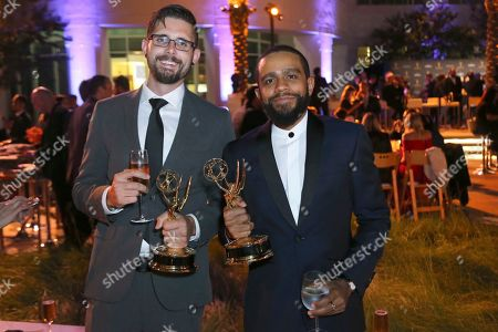 "Stock Picture of David Sherbrook, John Rosario. EXCLUSIVE David Sherbrook left, and John Rosario, from Spectrum SportsNet LA, winners of the Emmy for sports feature for ""Kirk Gibson Ceremonial First Pitch"",attend the 71st Los Angeles Area Emmy Awards at the Saban Media Center at Television Academy's North Hollywood, Calif. headquarters on"