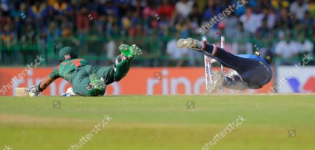 Stock Image of Sri Lanka's wicketkeeper Kusal Perera, right, successfully breaks the wicket to run out Bangladeshes' Sabbir Rahman during the second one-day international cricket match between Sri Lanka and Bangladesh in Colombo, Sri Lanka
