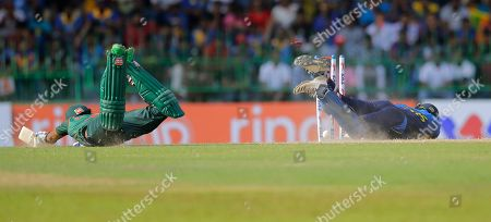 Stock Picture of Sri Lanka's wicketkeeper Kusal Perera, right, successfully breaks the wicket to run out Bangladeshes' Sabbir Rahman during the second one-day international cricket match between Sri Lanka and Bangladesh in Colombo, Sri Lanka