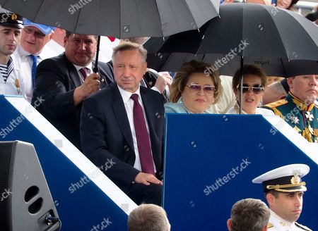 St. Petersburg's acting governor Alexander Beglov, center left, and Federation Council Speaker Valentina Matviyenko, center right, watch the military parade during the Navy Day celebration in St.Petersburg, Russia