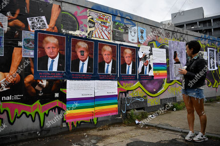 Artist STOT21stcplanB's work 'Boris Borump' which depicts both US President Donald Trump and British Prime Minister Boris Johnson is displayed on a wall in east London, Britain 28 July 2019. Boris Johnson defeated Jeremy Hunt to become the new British Prime Minister.