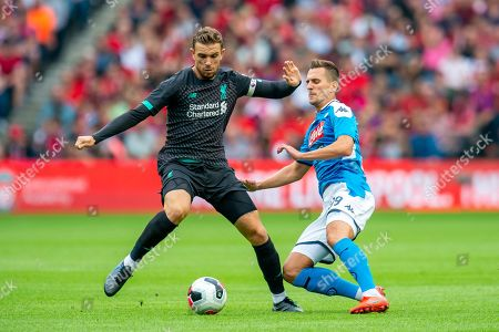 Arkadiusz Milik (#99) of SSC Napoli tackles Jordan Henderson (#14) of Liverpool FC during the Pre-Season Friendly match between Liverpool FC and SSC Napoli at BT Murrayfield Stadium, Edinburgh