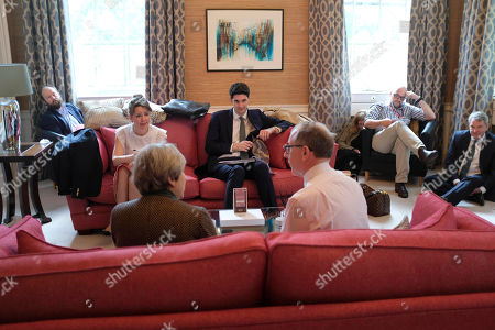 Prime Minister Theresa May and her husband Philip in a meeting at the No10 flat this evening, being briefed for the One Show appearance, with Lynton Crosby sitting on floor (far R) Mark Textor (2nd R) sitting in chair, Liz Sanderson (3rd R) on floor. Sitting on sofa opposite Tom Swarbrick next to Fiona Hilton and Nick Timothy (far L behind sofa).