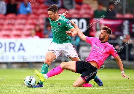 Cork City vs Shamrock Rovers. Cork City's Gearoid Morrissey is tackled by Dylan Watts of Shamrock Rovers