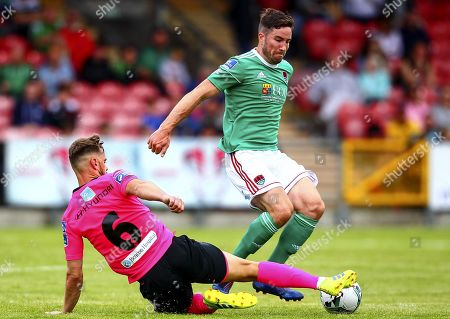 Cork City vs Shamrock Rovers. Greg Bolger of Shamrock Rovers tackles Cork City's Gearoid Morrissey