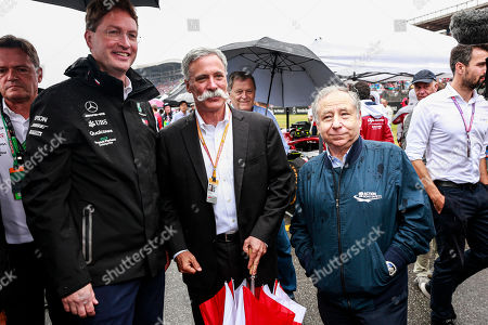 Motorsports: FIA Formula One World Championship 2019, Grand Prix of Germany,  Ola Källenius (SWE, Chairman of the Board of Management of Daimler AG), Chase Carey (USA, CEO of Formula One Group), Jean Todt (FRA, FIA President),