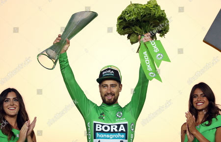 Slovakia's Peter Sagan wearing the best sprinter's green jersey celebrates on the podium after the twenty-first stage of the Tour de France cycling race over 128 kilometers (79.53 miles) with start in Rambouillet and finish in Paris, France
