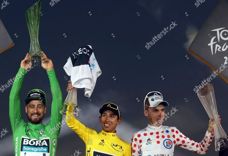 Slovakia's Peter Sagan wearing the best sprinter's green jersey, Colombia's Egan Bernal wearing the overall leader's yellow jersey, France's Romain Bardet wearing the best climber's dotted jersey, celebrate on the podium after the twenty-first stage of the Tour de France cycling race over 128 kilometers (79.53 miles) with start in Rambouillet and finish in Paris, France