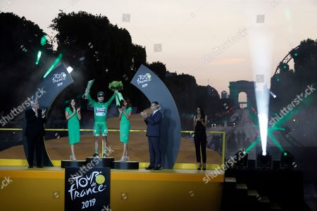 Slovakia's Peter Sagan wearing the best sprinter's green jersey celebrates on the podium on the podium after the twenty-first stage of the Tour de France cycling race over 128 kilometers (79.53 miles) with start in Rambouillet and finish in Paris, France