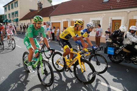 Slovakia's Peter Sagan wearing the best sprinter's green jersey, Colombia's Egan Bernal wearing the overall leader's yellow jersey, France's David Gaudu wearing the best young rider's white jersey, and France's Julian Alaphilippe ride during the twenty-first stage of the Tour de France cycling race over 128 kilometers (79.53miles) with start in Rambouillet and finish in Paris, France