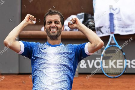 Albert Ramos-Vinolas of Spain celebrates after defeating Cedrik-Marcel Stebe of Germany in their final match of the Swiss Open tennis tournament in Gstaad, Switzerland, 28 July 2019.