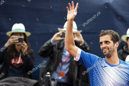 Albert Ramos-Vinolas (R) of Spain celebrates after defeating Cedrik-Marcel Stebe of Germany in their final match of the Swiss Open tennis tournament in Gstaad, Switzerland, 28 July 2019.