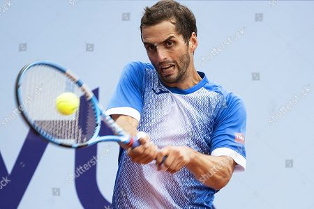 Albert Ramos-Vinolas of Spain in action against Cedrik-Marcel Stebe of Germany during their final match of the Swiss Open tennis tournament in Gstaad, Switzerland, 28 July 2019. Ramos-Vinolas won the final.
