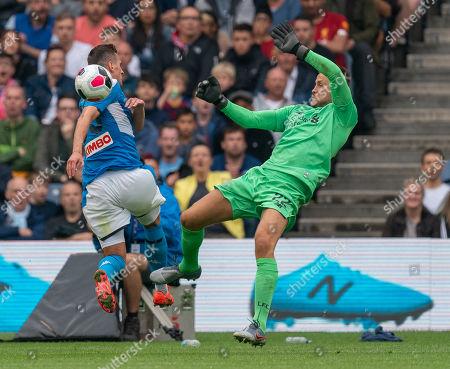 Liverpool goalkeeper Simon Mignolet saves at close range from Arek Milik of SSC Napoli