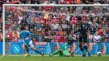Amin Younes of SSC Napoli shoots past Liverpool goalkeeper Simon Mignolet to give Napoli a 0-3 lead.