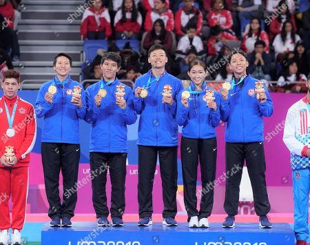 Lee Alex, Lee Andrew, Sun Ethan, Yi Sae - Jin and Real Karyn of tha US team pose with the gold medals after the Pan American Games Lima 2019 Taekwondo Mixed Team Poomsae Freestyle Final event, in Lima, Peru, 28 July 2019.