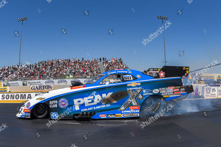 John Force completes a burnout in the semi-finals but cannot complete the run when his car will not come out of reverse gear during the NHRA Sonoma Nationals at Sonoma Raceway in Sonoma, California