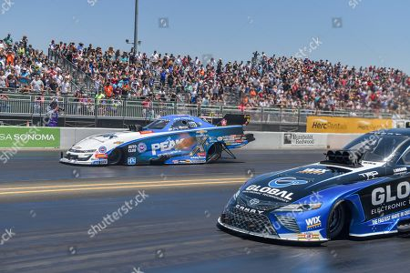 John Force in his Peak funny car wins his second round elimination race during the NHRA Sonoma Nationals at Sonoma Raceway in Sonoma, California