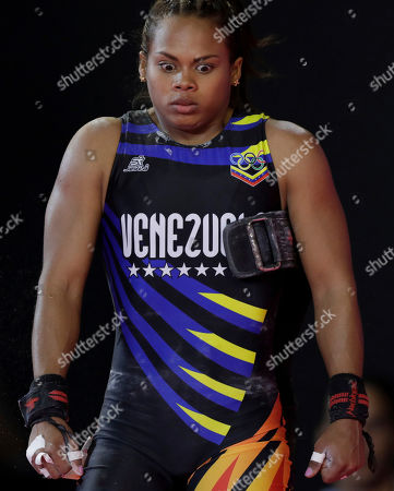 Stock Image of Genesis Rodriguez of Venezuela competes for the gold in clean and jerk women's 55 kg weightlifting event at the Pan American Games in Lima, Peru,. Rodriguez won the gold