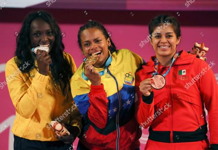 Silver medalist Yenni Sinisterra of Colombia, left, gold medalist Genesis Rodriguez of Venezuela, center, and bronze medalist Ana Lopez of Mexico show their medals during the podium ceremony for the women's 55 kg weightlifting event at the Pan American Games in Lima, Peru