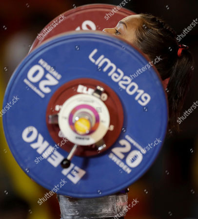 Stock Photo of Genesis Rodriguez of Venezuela competes for the gold in the women's clean and jerk 55 kg weightlifting event at the Pan American Games in Lima, Peru,. Rodriguez won the gold