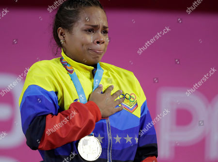 Stock Picture of Genesis Rodriguez cries during the medals ceremony for the women's 55 kg weightlifting event at the Pan American Games in Lima, Peru,. Rodriguez won the gold
