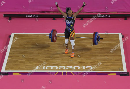 Genesis Rodriguez of Venezuela celebrates after lifting 96 Kg during the women's snatch weightlifting 55 kg event at the Pan American Games in Lima, Peru