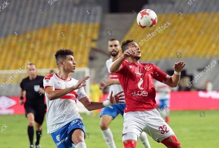 Stock Image of Al Ahly's Ramadan Sobhi (R) in action against Zamalek's Mohamed Abdel Ghany (L) during the Egyptian League soscer match between Al Ahly SC and Zamalek SC at Borg Al-Arab Stadium in Alexandria, Egypt, 28 July 2019.