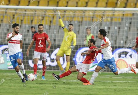 Stock Image of Zamalek players Ferjani Sassi (L) and Mo Ibrahim (R) in action against Ahly player Walid Soliman (C) during the Egyptian league soccer match between Zamalek and Al-Ahly at Borg Al-Arab Stadium in Alexandria, Egypt, 28 July 2019.
