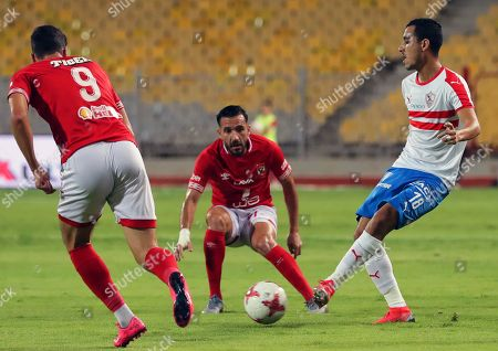 Zamalek's Ibrahim Hassan (R) in action against Al Ahly players Ali Maaloul (C) and Walid Azaro (L) during the Egyptian League soscer match between Al Ahly SC and Zamalek SC at Borg Al-Arab Stadium in Alexandria, Egypt, 28 July 2019.