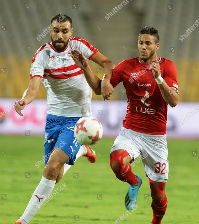 Stock Photo of Al Ahly's Ramadan Sobhi (R) in action against Zamalek's Hamdi El-Nagguez (L) during the Egyptian League soccer match between Al Ahly SC and Zamalek SC at Borg Al-Arab Stadium in Alexandria, Egypt, 28 July 2019.