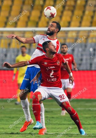 Al Ahly's Ramadan Sobhi (front) in action against Zamalek's Hamdi El-Nagguez (back) during the Egyptian League soccer match between Al Ahly SC and Zamalek SC at Borg Al-Arab Stadium in Alexandria, Egypt, 28 July 2019.