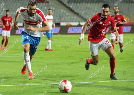 Al Ahly's Ali Maaloul (R) in action against Zamalek's Hamdi El-Nagguez (L) during the Egyptian League soccer match between Al Ahly SC and Zamalek SC at Borg Al-Arab Stadium in Alexandria, Egypt, 28 July 2019.