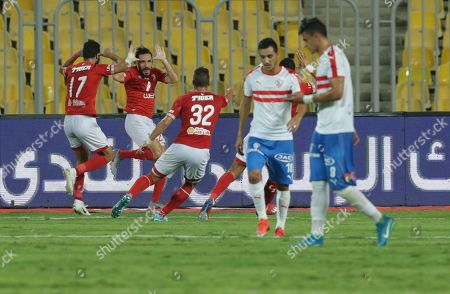 Al Ahly player Ali Maaloul (2nd L) celebrates after scoring a goal during the Egyptian league soccer match between Zamalek and Al-Ahly at Borg Al-Arab Stadium in Alexandria, Egypt, 28 July 2019.