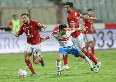Al Ahly player Mohamed Hany (R) and Ali Maaloul (L) in action against Zamalek player Ayman Hefny during the Egyptian league soccer match between Zamalek and Al-Ahly at Borg Al-Arab Stadium in Alexandria, Egypt, 28 July 2019.